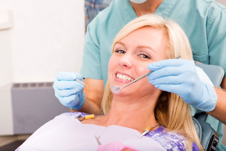 photo of a woman having teeth whitening in milton